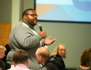 OUTLOOK PHOTO: JOSH KULLA - Jarvez Hall, executive director of the East County Economic Alliance, discusses what makes a team player in the workplace Wednesday at the Gresham Area Chambers economic summit.