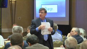 Mike Hourigan holding a Sales Negotiation Skills Training